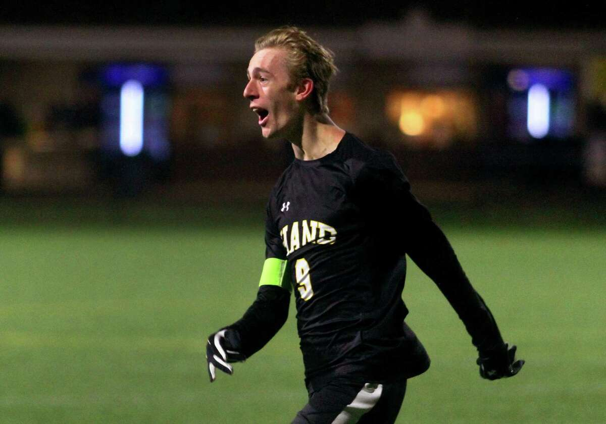 Hand's Jack Green celebrates a tie-breaking goal against Wilton during the Class L state final on Saturday.
