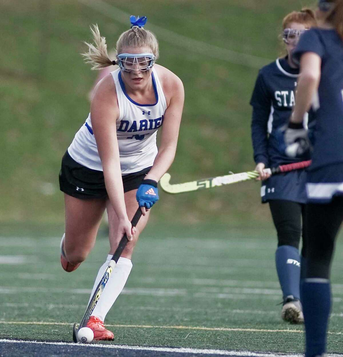 Darien High School's Charlotte Domittner moves the ball up the field in the Class L state field hockey championship game against Staples High School, played at Wethersfield High School. Saturday, Nov. 23, 2019