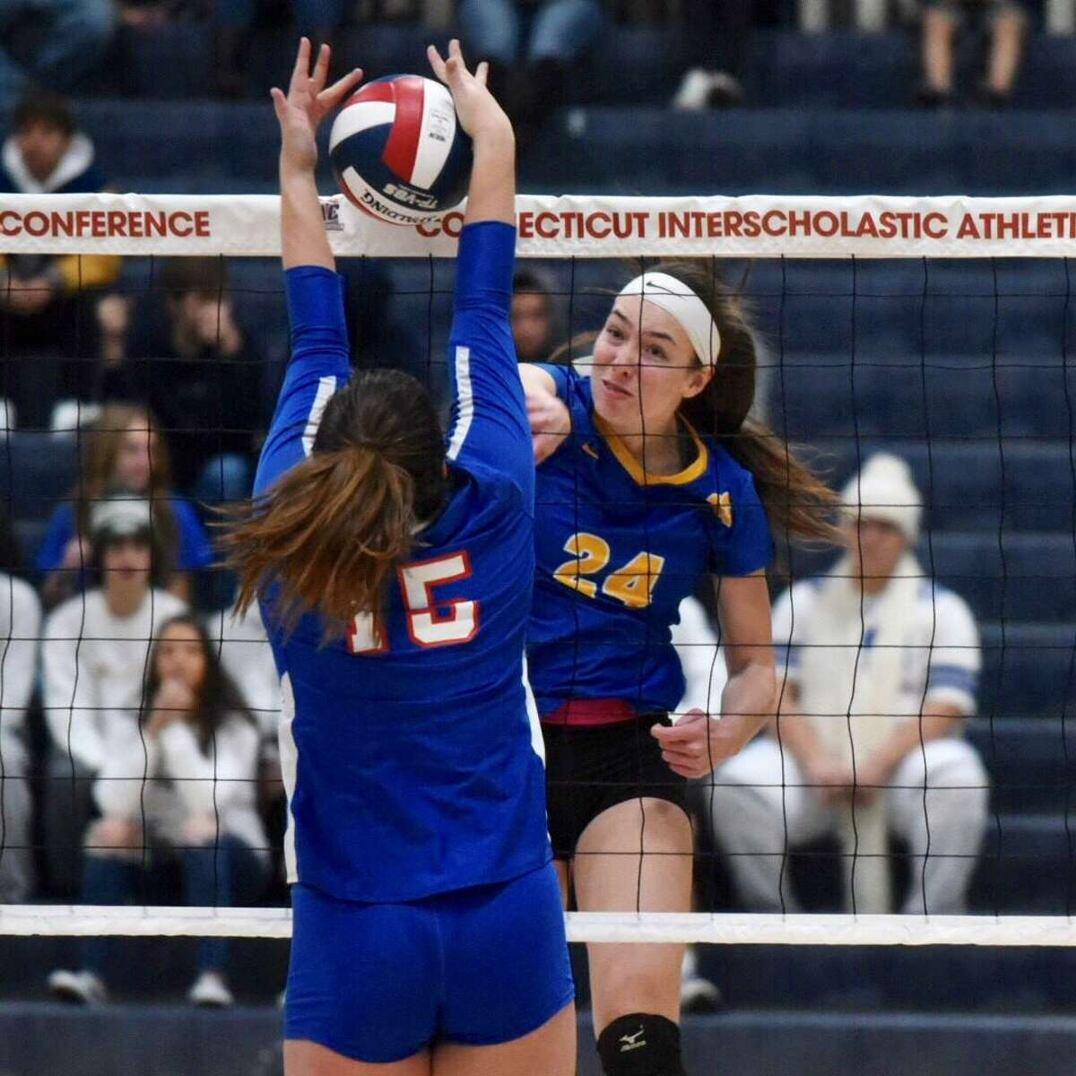 Seymour's Faith Rousseau (24) puts a shot last Waterford's Sabrina Kobyluck (15) during the CIAC Class M volleyball final at East Haven High on Saturday.