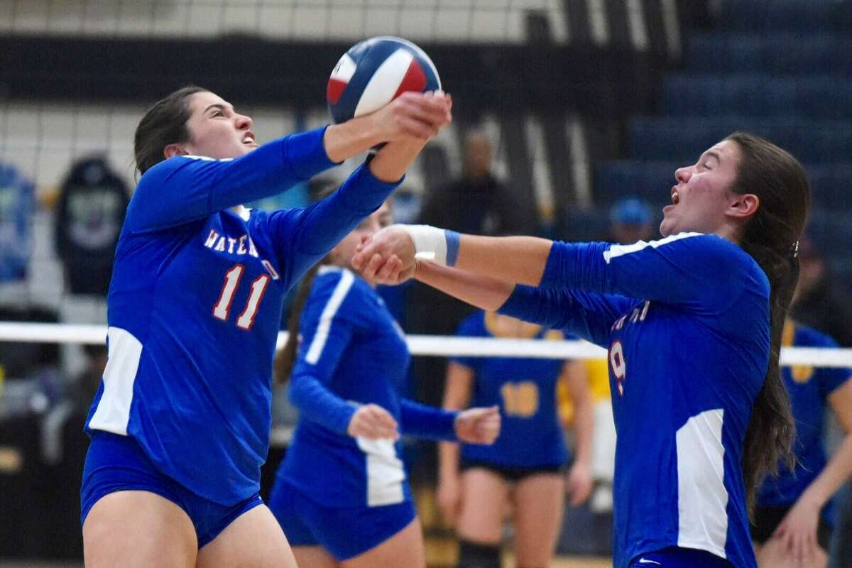 Waterford's Rachel Miller (11) keeps the ball up in front of Angela Colonis (9) during the CIAC Class M volleyball final between Waterford and Seymour at East Haven High School on Saturday, Nov. 23, 2019.