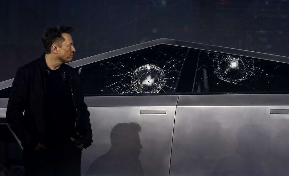 Tesla CEO Elon Musk looks at the broken window glass as he introduces the Cybertruck at Tesla's design studio Thursday, Nov. 21, 2019, in Hawthorne, Calif. Musk is taking on the workhorse heavy pickup truck market with his latest electric vehicle. (AP Photo/Ringo H.W. Chiu) Photo: Ringo H.W. Chiu, Associated Press