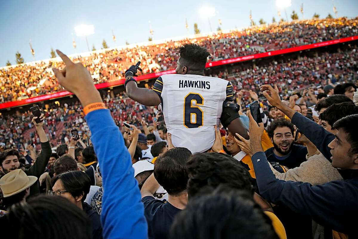 California Golden Bears safety Jaylinn Hawkins (6) is lifted into the air following the 122nd Big Game against the Stanford Cardinal at Stanford Stadium on Saturday, Nov. 23, 2019, in Stanford, Calif. The California Golden Bears won 24-20.