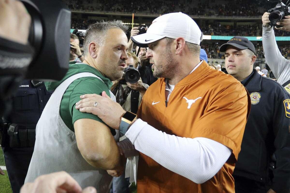 Baylor head coach Matt Rhule, left, and Texas head coach Tom Herman shake hands after an NCAA college football game Saturday, Nov. 23, 2019, in Waco, Texas. (AP Photo/Richard W. Rodriguez)