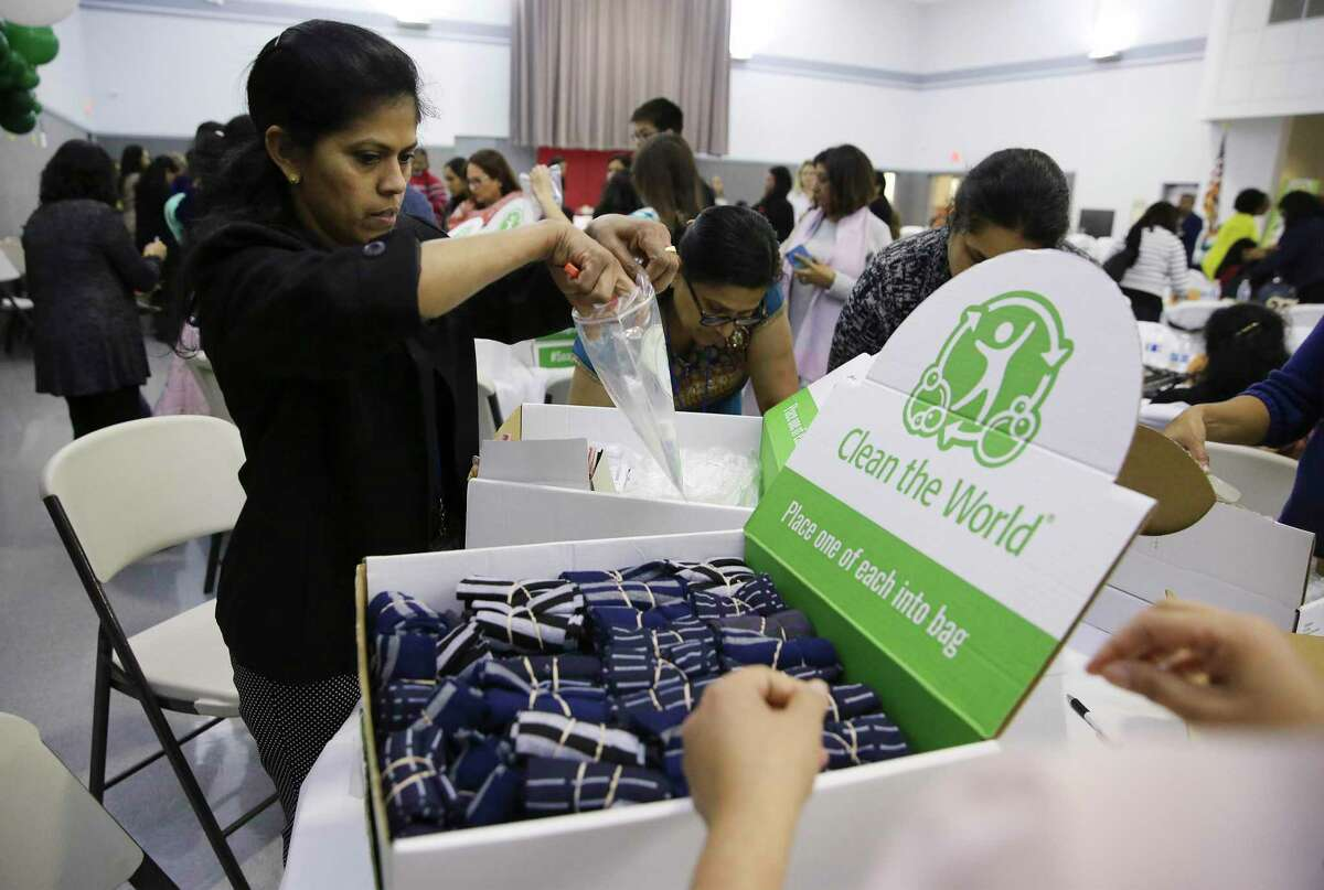 Registered Nurse Bindu Kottanal places items into a bag as members of the San Antonio Indian Nurses' Association assemble 1000 hygiene kits to be donated to Haven for Hope and Child Advocates San Antonio as part of the association's inaugural conference & gala on Saturday, Nov. 23, 2019. The hygiene kits contained shampoo, conditioner and bar soap that was recycled by the organization Clean the World, which donates cleaning products that large hotels would otherwise discard. Also in each kit was a pair of socks, a toothbrush and tooth paste and a handwritten inspirational note from the group's volunteers.