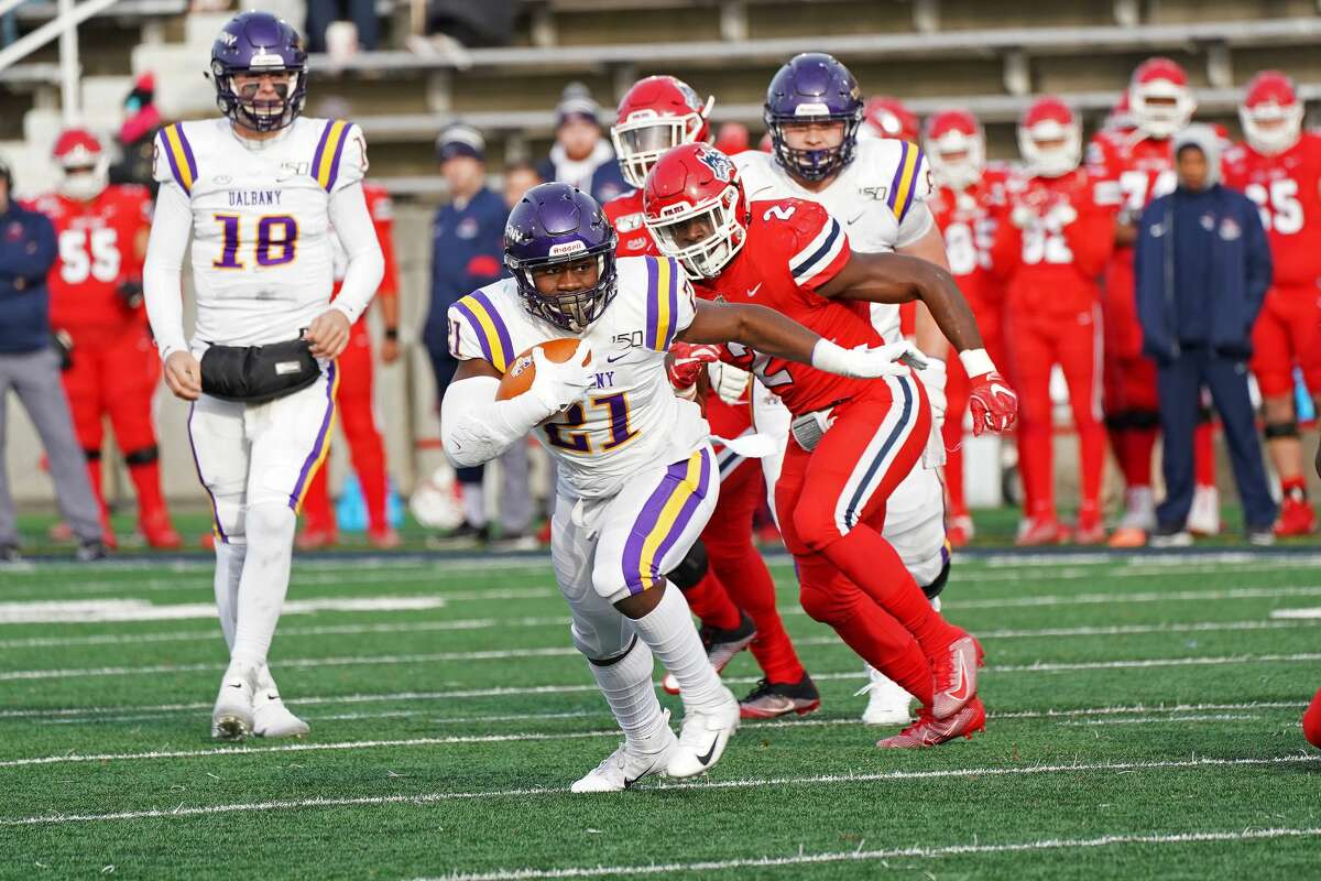 UAlbany's Karl Mofor carries the ball in the Great Danes' 31-26 victory at Stony Brook on Saturday, Nov. 23, 2019. (Gregory A. Shemitz / Special to the Times Union)