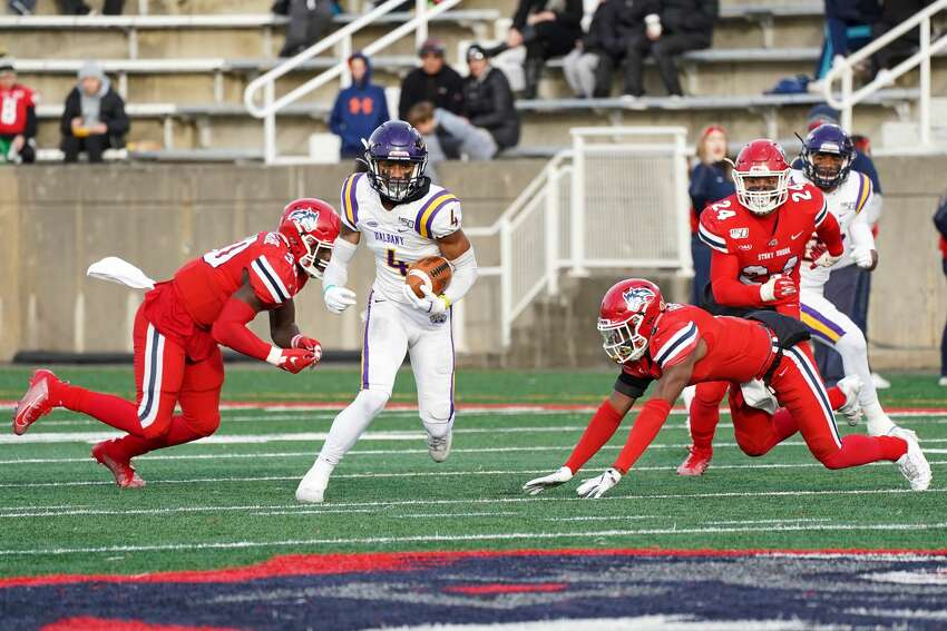 UAlbany's Juwan Green finds an opening in the Stony Brook defense after making a catch in the Great Danes' 31-26 victory at Stony Brook on Saturday, Nov. 23, 2019. (Gregory A. Shemitz / Special to the Times Union)