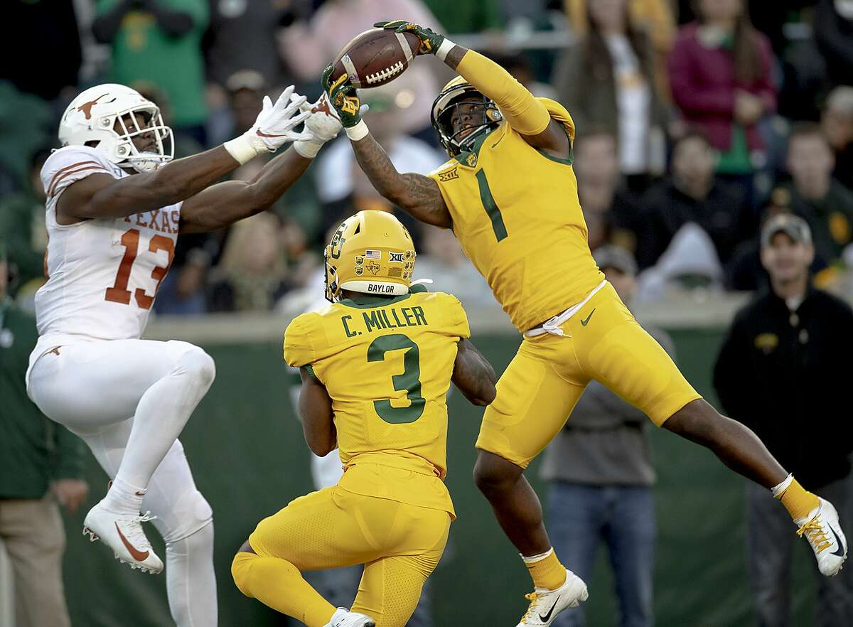 Baylor cornerback Grayland Arnold (1) intercepts a pass intended for Texas wide receiver Brennan Eagles (13) during an NCAA college football game on Saturday, Nov. 23, 2019, in Waco, Texas.