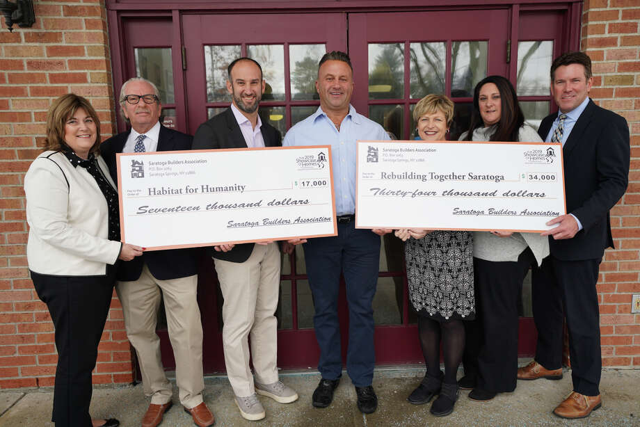 The Saratoga Builders Association presented checks to nonprofits following the 2019 Showcase of Homes. L-R: Martha McQuigge, Saratoga National Bank; Barry Potoker, builders association; Adam Feldman, Executive Director, Habitat for Humanity of Northern Saratoga, Warren & Washington Counties; Dave Trojanski, President, builders association; Michelle Larkin, Executive Director, Rebuilding Together Saratoga County; Lisa Licata, Sterling Homes; Mark Hogan,Saratoga National Bank. (Photo provided)