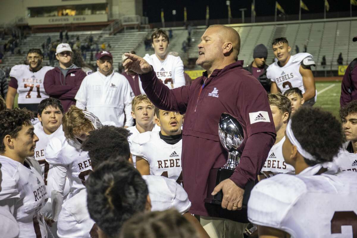 Lee head coach ClintHartman talks to the players after winning the Class 6A Division I area playoff game Saturday, Nov. 23, 2019 at Cravens Stadium in Arlington. Jacy Lewis/Reporter-Telegram