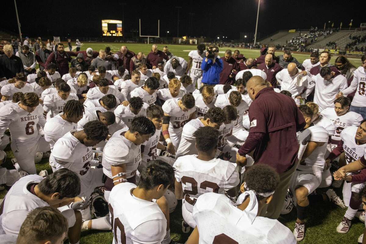 Lee players and coaches pray after winning 6A Division I area playoff game Saturday, Nov. 23, 2019 at Cravens Stadium in Arlington. Jacy Lewis/Reporter-Telegram