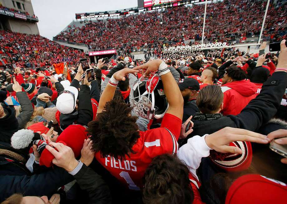 "Ohio State Buckeyes quarterback Justin Fields (1) sings ""Carmen Ohio