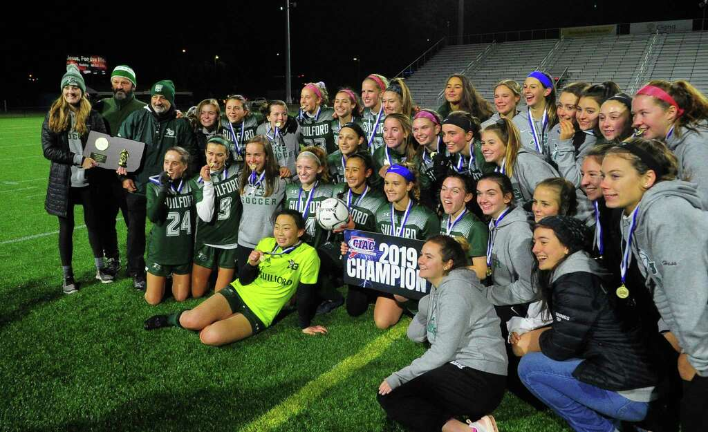 <p>Guilford team members pose with the CIAC trophy after beating East Lyme during CIAC State Girls Soccer Tournament action in Hartford, Conn., on Saturday Nov. 23, 2019.</p>