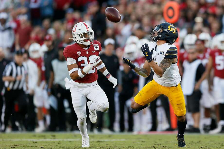The Big Game would be one of 10 games on the schedules of Cal and Stanford during the shortened 2020 season if the Pac-12 finalizes its conference-only plans. In this play from the 2019 Big Game, Bears wide receiver Nikko Remigio (4) makes a catch for a big gain against Cardinal safety Jonathan McGill (32) during Cal's 24-20 win. Photo: Santiago Mejia / The Chronicle 2019
