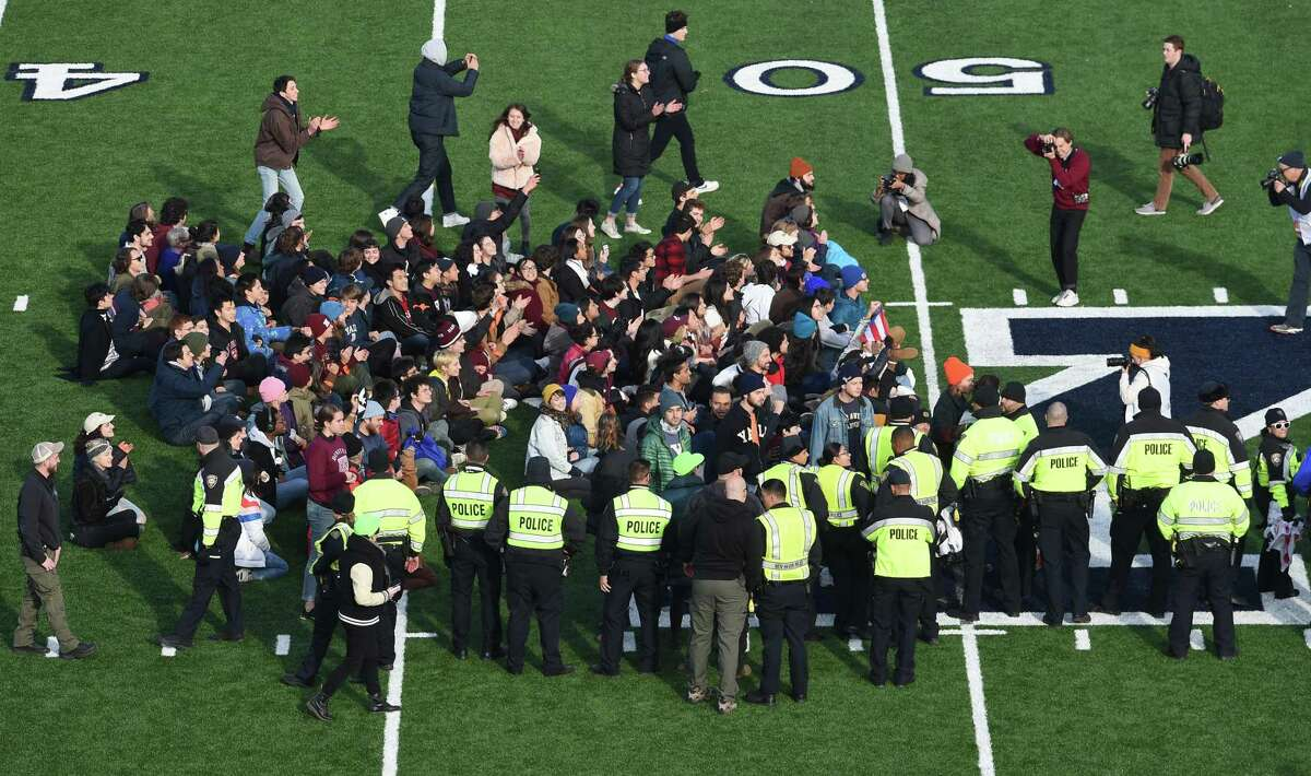 Fans stage a climate change protest at the Yale Bowl delaying the second half of the Yale/Harvard football game in New Haven Nov. 23, 2019.