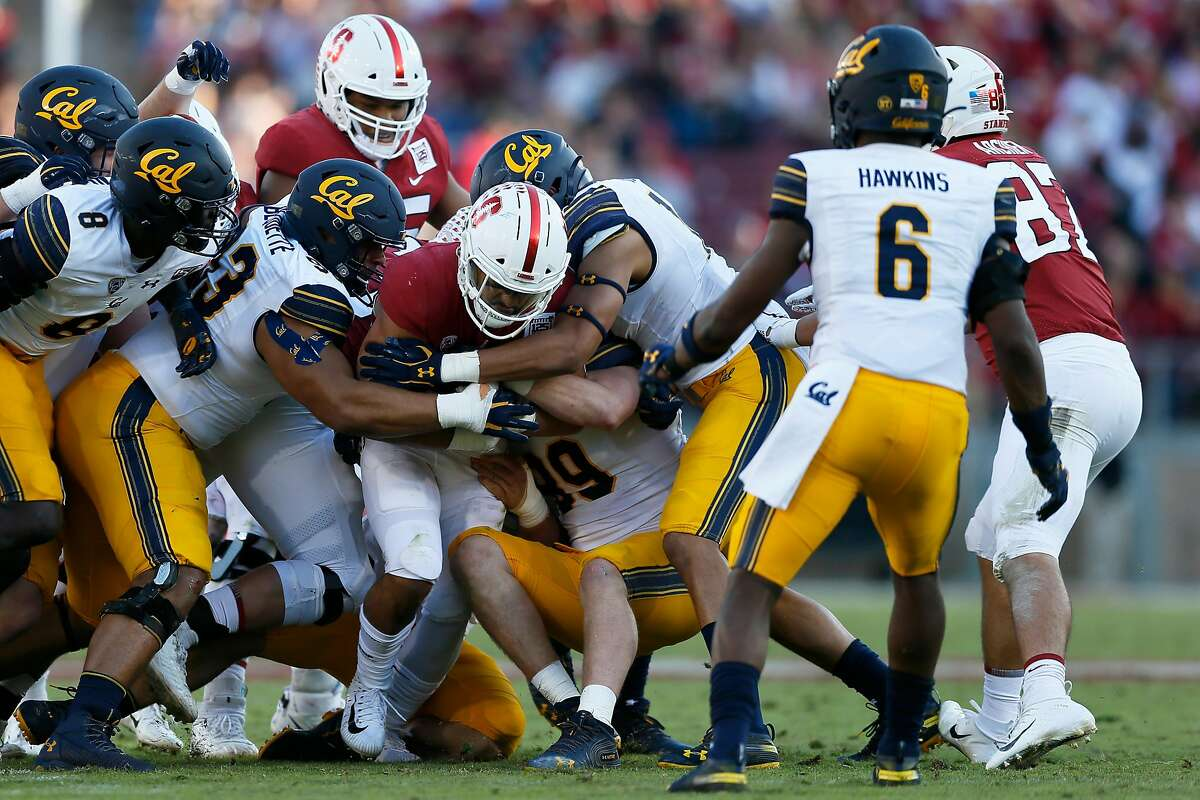 The California Golden Bears tackle Stanford Cardinal running back Cameron Scarlett (22) during the 122nd Big Game at Stanford Stadium on Saturday, Nov. 23, 2019, in Stanford, Calif. The California Golden Bears won 24-20.