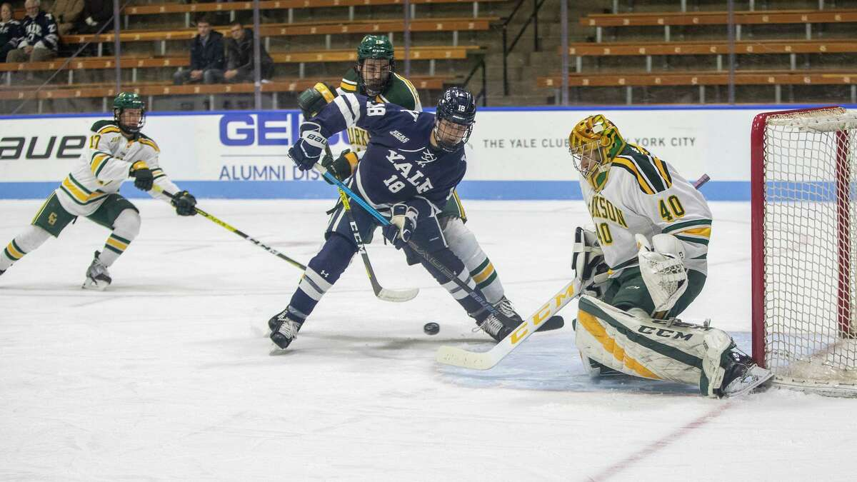 Yale's Justin Pearson looks to grab a rebound off Clarkson goalie Frank Marotte in 2019.