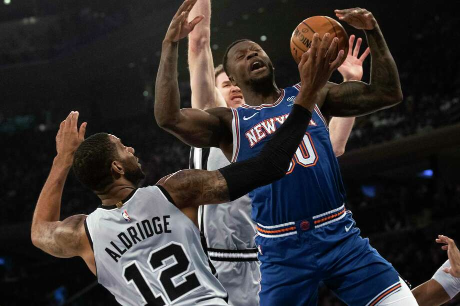 San Antonio Spurs center LaMarcus Aldridge (12) guards New York Knicks forward Julius Randle (30) in the first half of an NBA basketball game, Saturday, Nov. 23, 2019, at Madison Square Garden in New York. (AP Photo/Mary Altaffer) Photo: Mary Altaffer, STF / Associated Press / Copyright 2019 The Associated Press. All rights reserved.