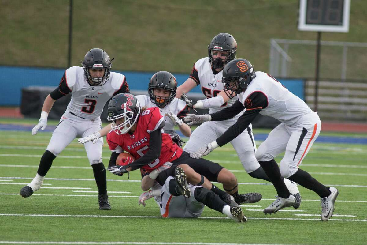 Port Jervis' Noah Brown is taken down by several Schuylerville players in the NYSPHSAA Class B Football East Semifinals in Middletown, NY on November 23, 2019.