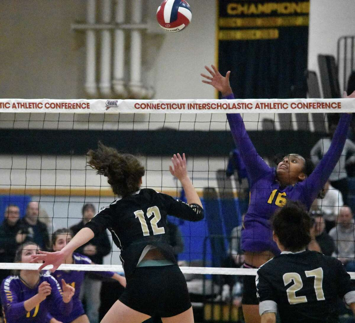 Westhill's Tamar Bellete tries to block a spike in the Class LL girls volleyball state championship match between Trumbull and Westhill at East Haven high, East Have on Saturday, Nov. 23, 2019. (Pete Paguaga, Hearst Connecticut Media)