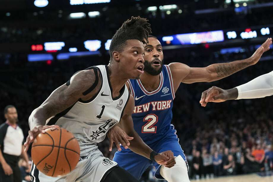 San Antonio Spurs guard Lonnie Walker IV (1) drives to the basket against New York Knicks guard Wayne Ellington (2) in the second half of an NBA basketball game, Saturday, Nov. 23, 2019, at Madison Square Garden in New York. The Spurs won 111-104. (AP Photo/Mary Altaffer) Photo: Mary Altaffer, Associated Press