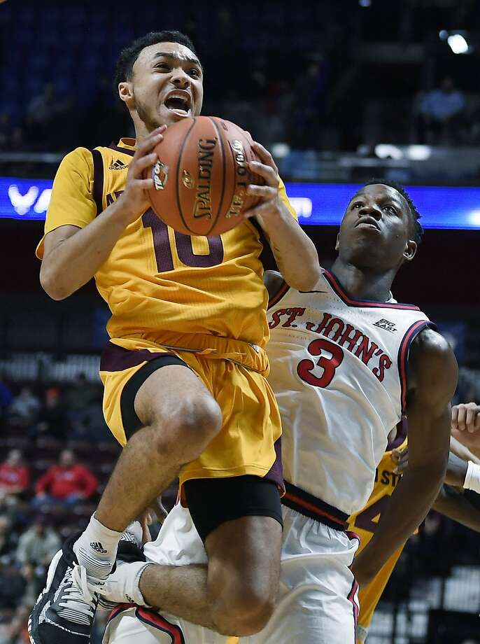 Jaelen House goes to the hoop up against St. John's Rasheem Dunn in the Sun Devils' win at the Hall of Fame Tip-Off Tournament in Uncasville, Conn. Photo: Jessica Hill / Associated Press