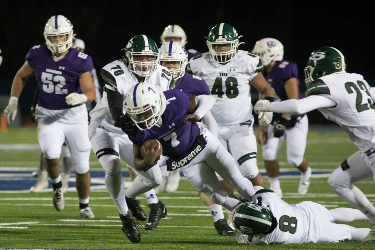 Shenendehowa's Collin Cook, left takes down New Rochelle's Tariq Benjamin, right in the NYSPHSAA Class AA Football East Semifinals in Middletown, NY on November 23, 2019.