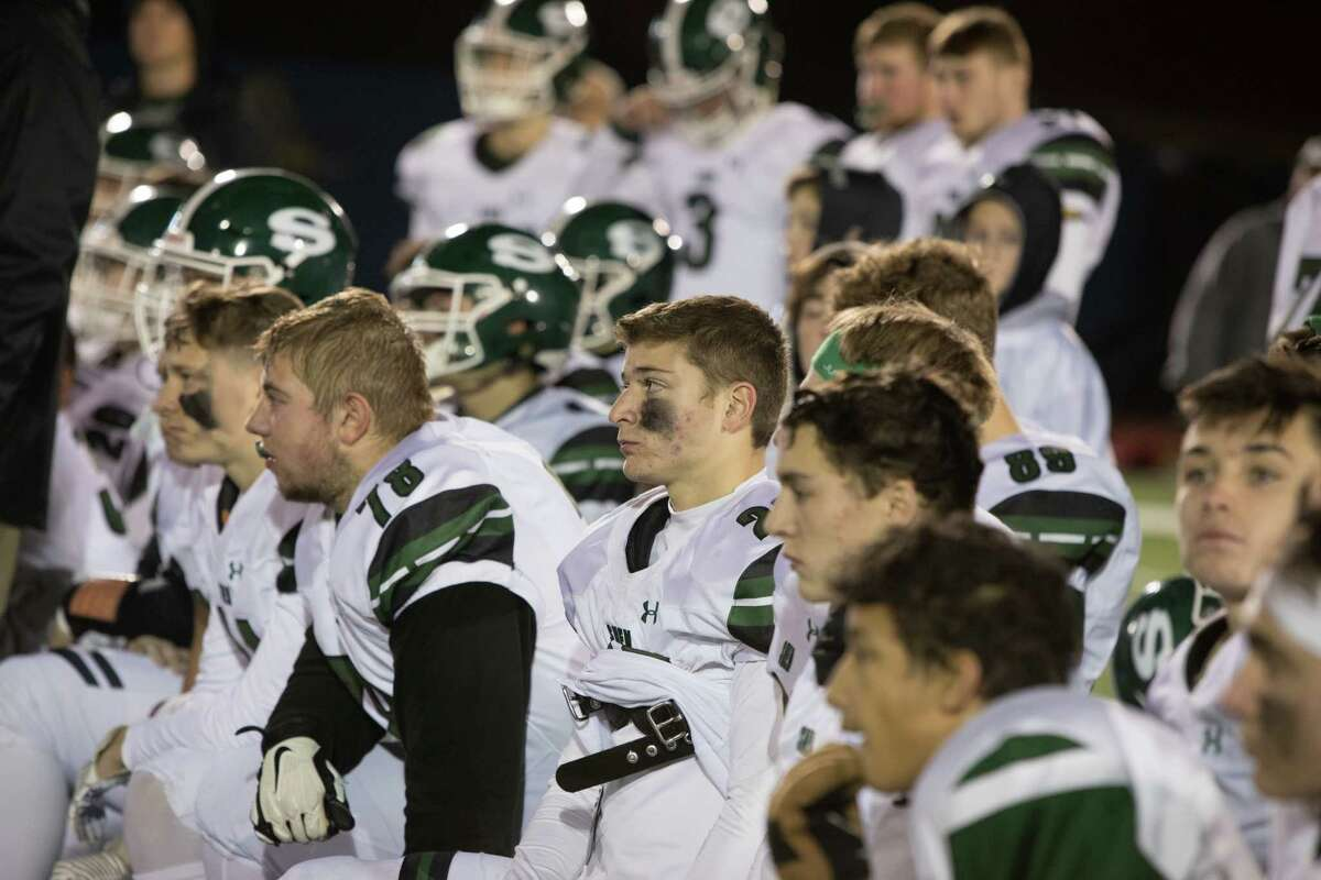 Shenendehowa players react to losing to New Rochelle in the NYSPHSAA Class AA Football East Semifinals in Middletown, NY on November 23, 2019.