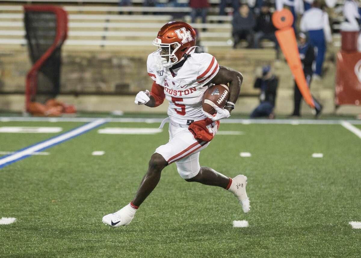 Houston wide receiver Marquez Stevenson returns a Tulsa kickoff during an NCAA college football game Saturday, Nov. 23, 2019, in Tulsa, Okla. (Brett Rojo/Tulsa World via AP)
