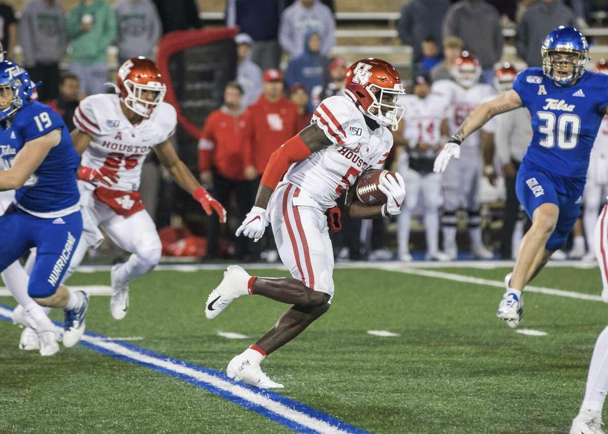Houston wide receiver Marquez Stevenson returns a kickoff for a touchdown against Tulsa during an NCAA college football game Saturday, Nov. 23, 2019, in Tulsa, Okla. (Brett Rojo/Tulsa World via AP)