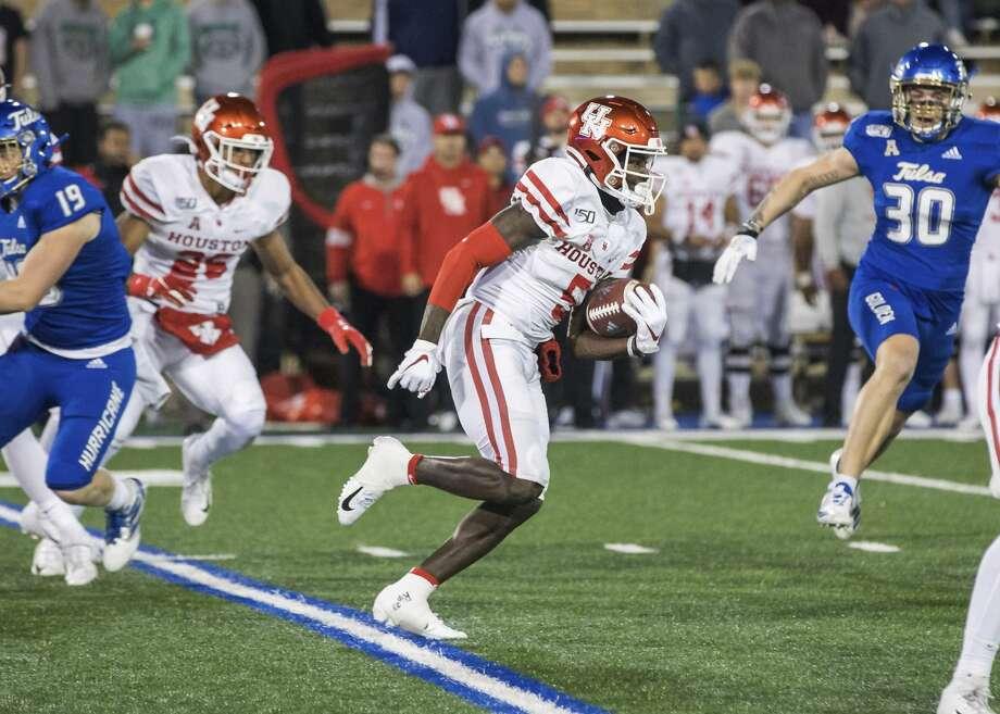 Houston wide receiver Marquez Stevenson returns a kickoff for a touchdown against Tulsa during an NCAA college football game Saturday, Nov. 23, 2019, in Tulsa, Okla. (Brett Rojo/Tulsa World via AP) Photo: Brett Rojo/Associated Press