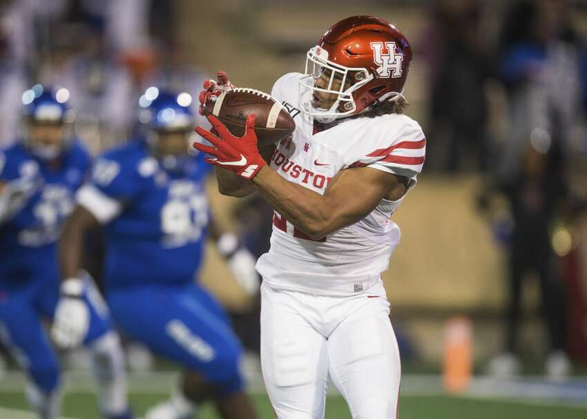 Houston running back Kyle Porter makes a reception during the team's NCAA college football game against Tulsa on Saturday, Nov. 23, 2019, in Tulsa, Okla. (Brett Rojo/Tulsa World via AP)