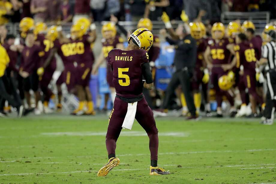 Arizona State quarterback Jayden Daniels celebrates after throwing for an 81-yard second-half touchdown against No. 6 Oregon. Photo: Matt York / Associated Press