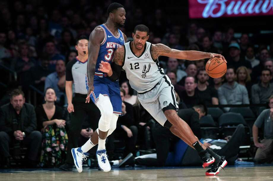 Spurs big man LaMarcus Aldridge, driving against the Knicks' Julius Randle, finished with a game-high 23 points. Photo: Mary Altaffer /Associated Press / Copyright 2019 The Associated Press. All rights reserved.