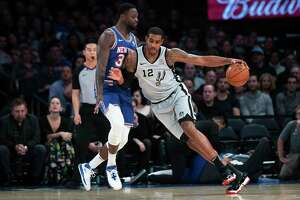 Spurs big man LaMarcus Aldridge, driving against the Knicks' Julius Randle, finished with a game-high 23 points.