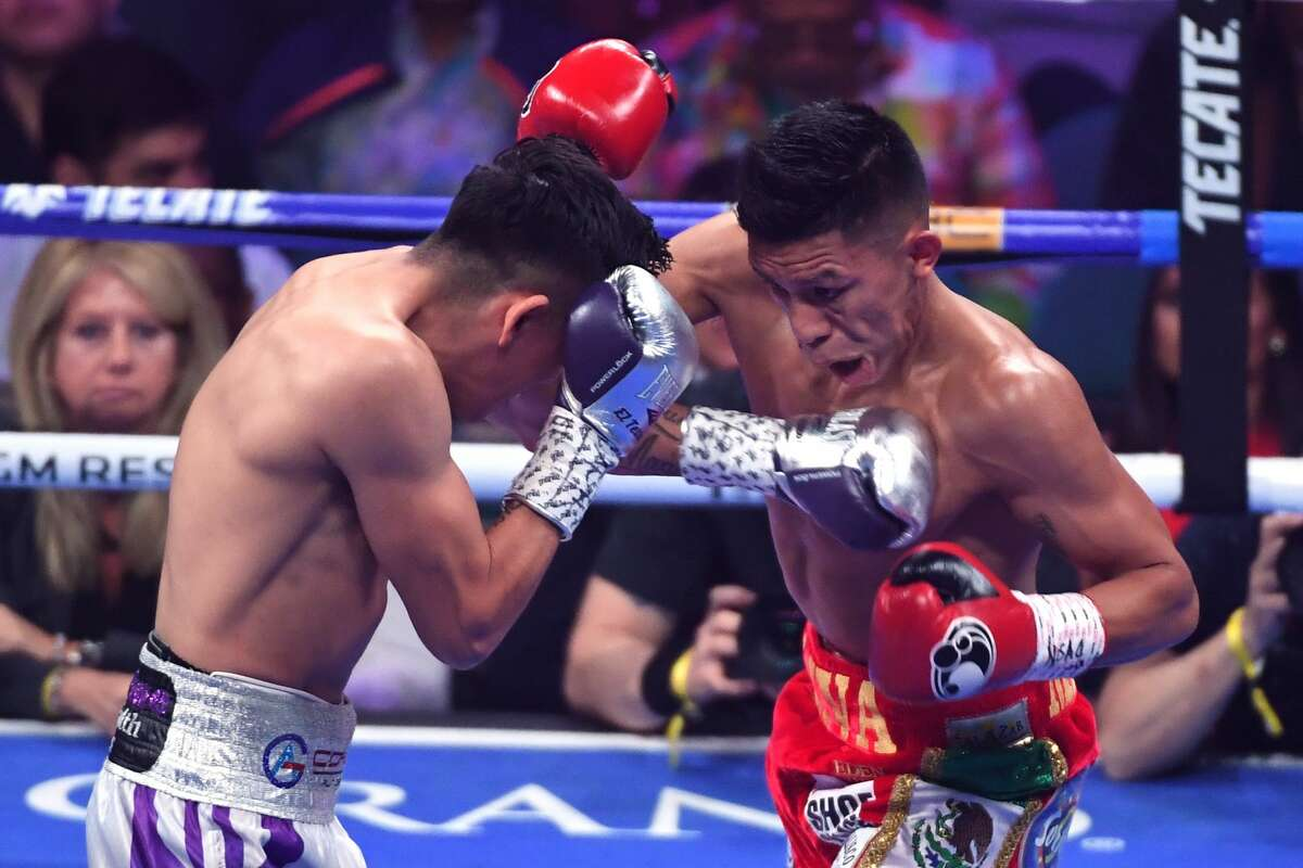 Leo Santa Cruz (L) hits Miguel Flores in the first round of their fight for a vacant WBA super featherweight title at MGM Grand Garden Arena on November 23, 2019 in Las Vegas, Nevada. Santa Cruz won by unanimous decision.