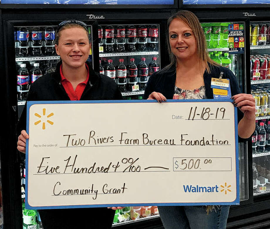 Rachel Smith (left), agriculture literacy coordinator for Pike-Scott Farm Bureau, accepts a commemorative $500 Walmart Community Grant check for Two Rivers Farm Bureau Foundation from Walmart Pittsfield location manager Tracey Snyder. The grant to the foundation will benefit the Pike-Scott bureau's Agriculture in the Classroom program. Photo: Photo Provided