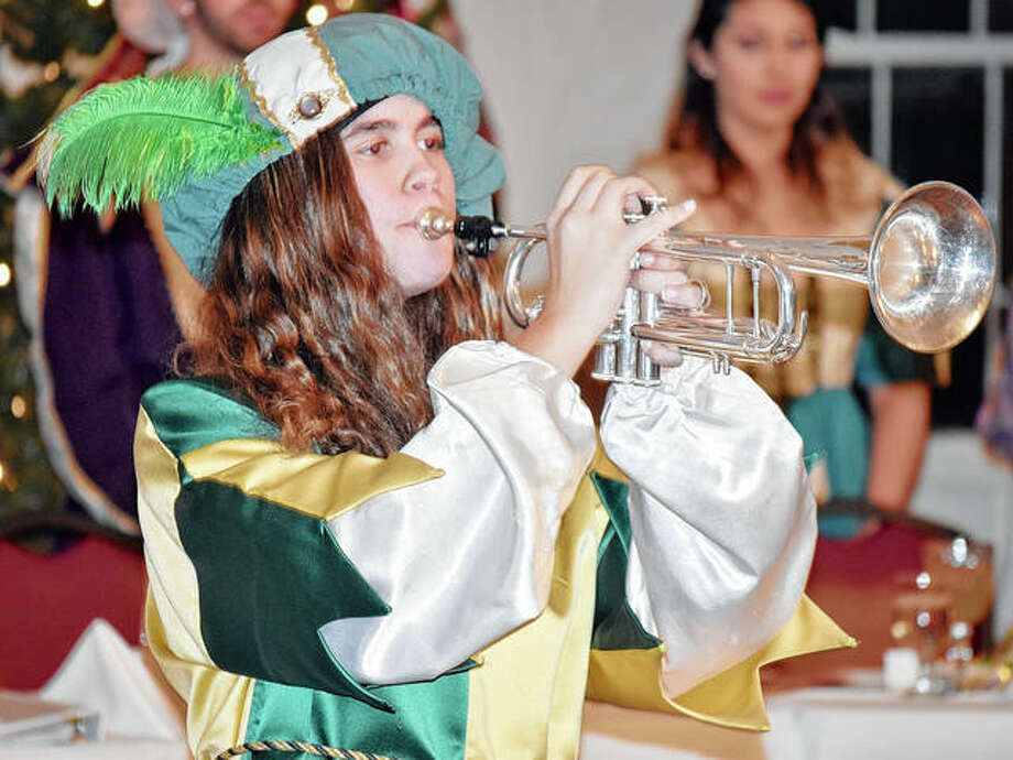 Alanya Barringer heralds a new portion of MacMurray College's madrigal dinner. Photo: Marco Cartolano | Journal-Courier