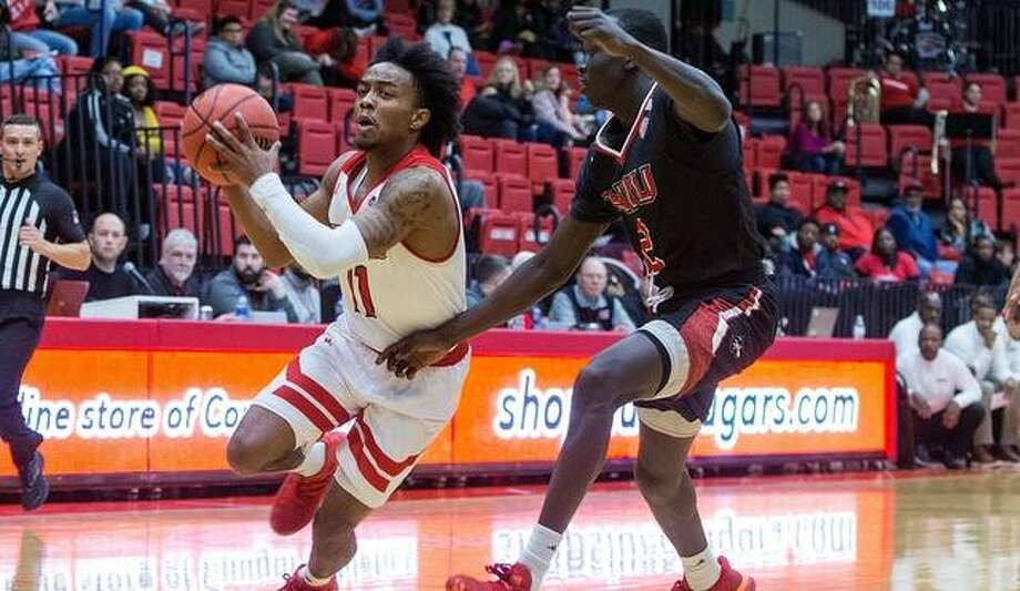 SIUE guard Tyresse Williford drives to the basket during action against Northern Illinois. Photo: SIUE