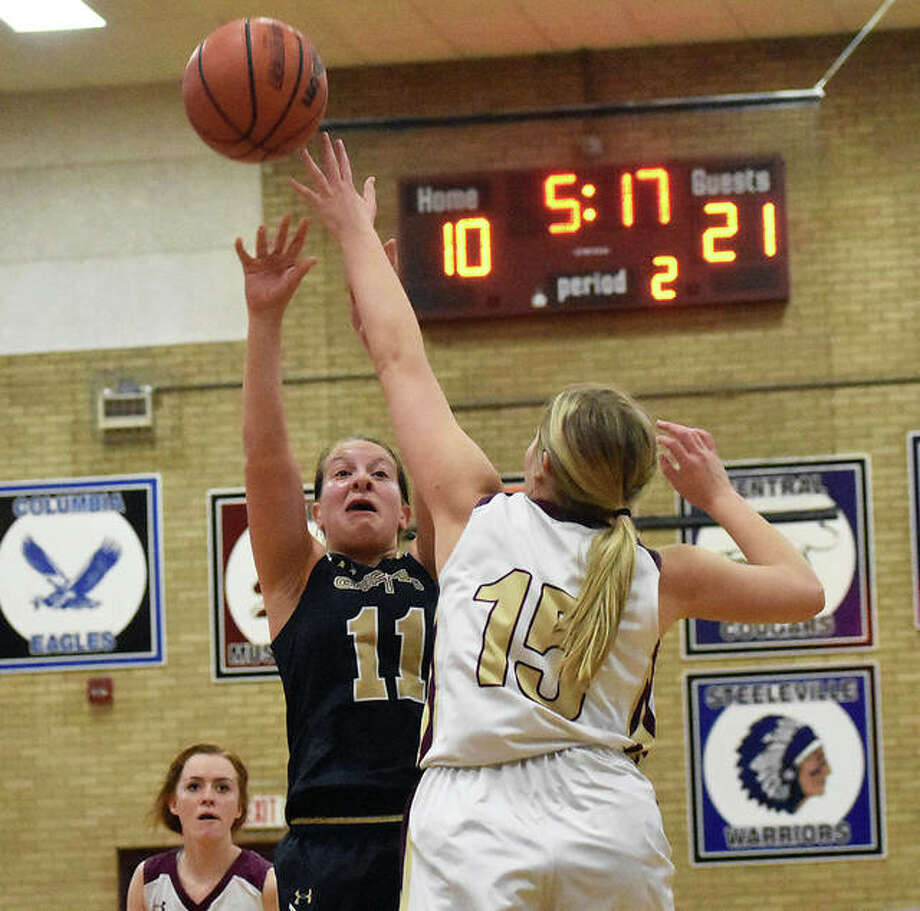 Father McGivney guard Macy Hoppes puts up a floater in the lane over an EA-WR defender in the second quarter in Dupo. Photo: Matt Kamp|The Intelligencer