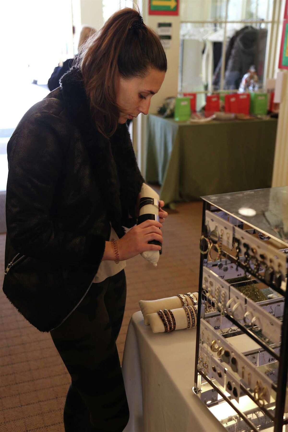 Brittany Santella of Fairfield looks at jewelry at the Holiday Pop-Up Market at the Fairfield Museum and History Center on Saturday, Nov. 23, 2019, in Fairfield, Conn.