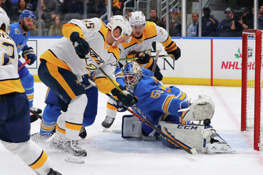 Blues goalie Jordan Binnington (50) makes a save against the Predators' Matt Duchene (95) during the first period Saturday night in St. Louis. Photo: Associated Press