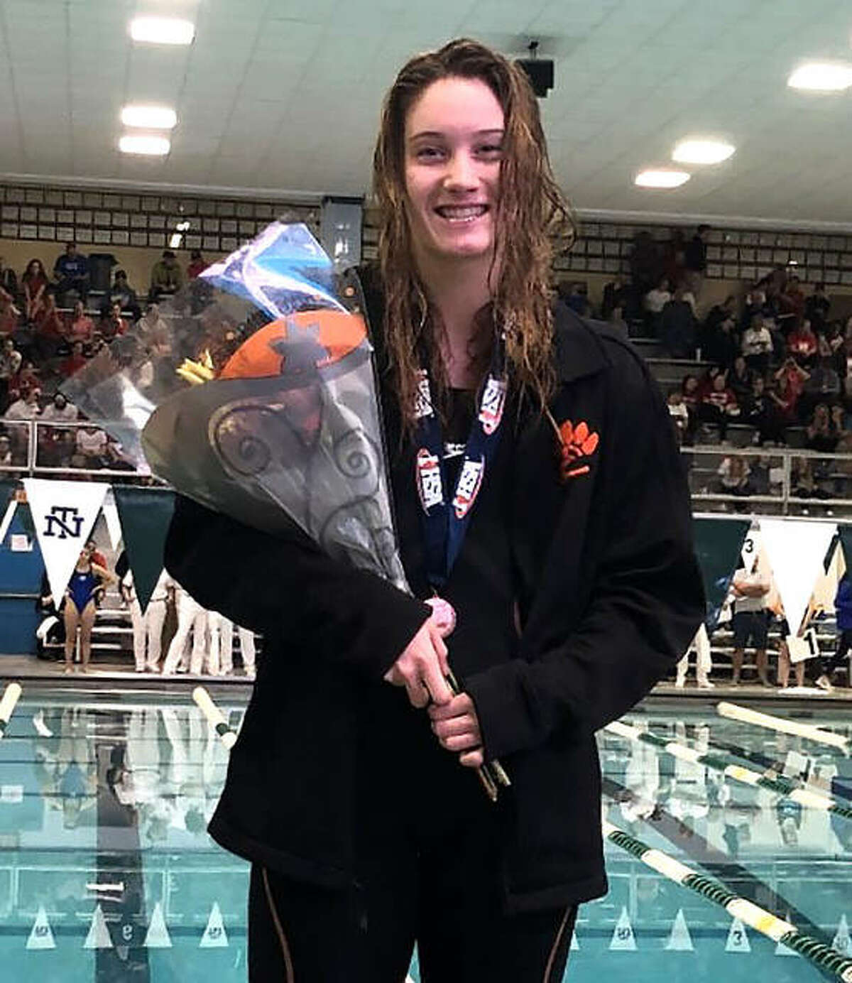 Edwardsville senior Josie Bushell poses with her medal after placing 12th in the 100-yard freestyle on Saturday in the finals of the state meet at New Trier High School.