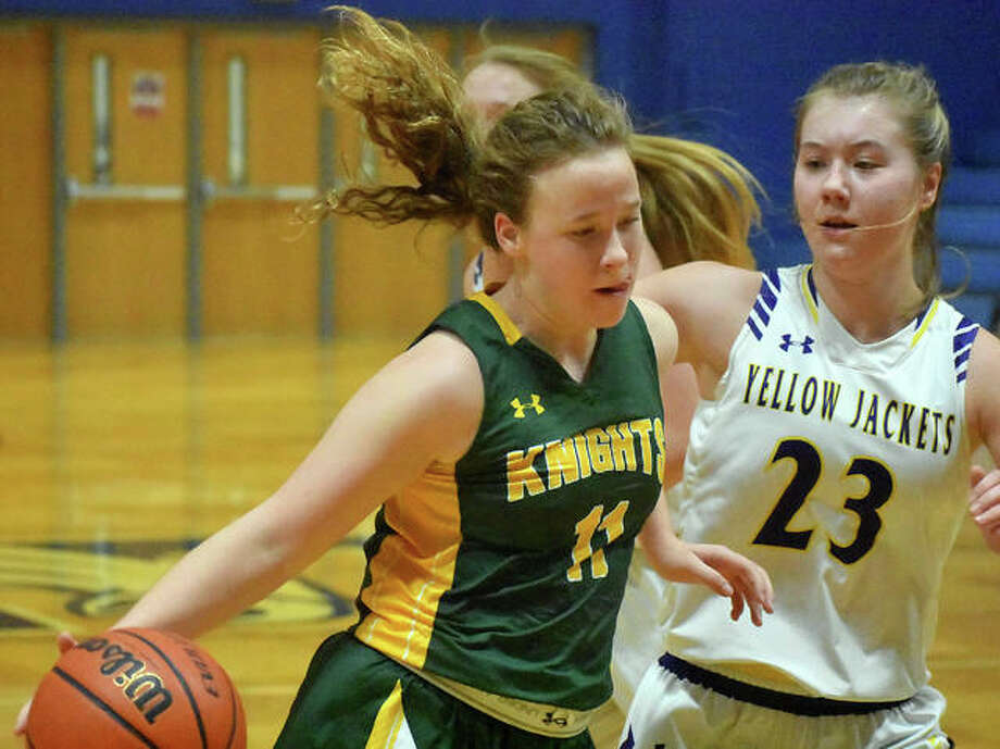 Metro-East Lutheran's Caitlin Reynolds drives to the basket in the third quarter. Photo: Matt Kamp|The Intelligencer