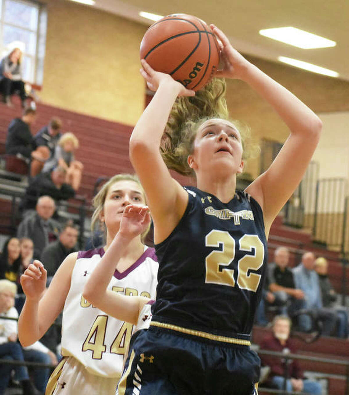 Father McGivney's Charlize Luehmann (22) puts up a shot after getting past EA-WR's Aubrey Robinson on Saturday at the Dupo Cat Classic.