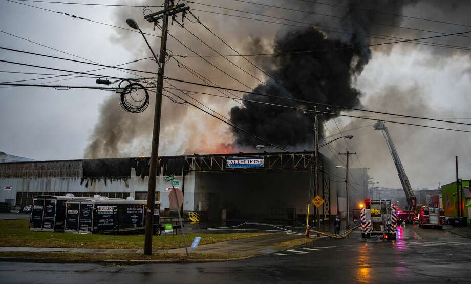 Smoke billows from a warehouse building at 27 Thacher St., Albany on Sunday. Smoke from the fire could be seen across the Hudson River in Rensselaer. Photo: Eli Gill / Special To The Times Union / ELI GILL