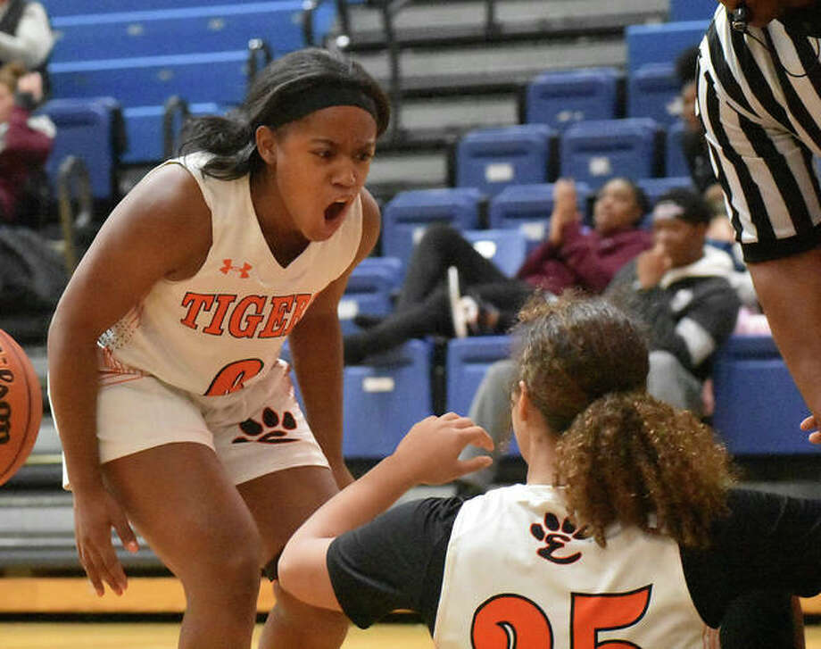 Edwardsville point guard Quierra Love is fired up after Sydney Harris hits a contested shot and draws a foul in the first quarter against Ladue.