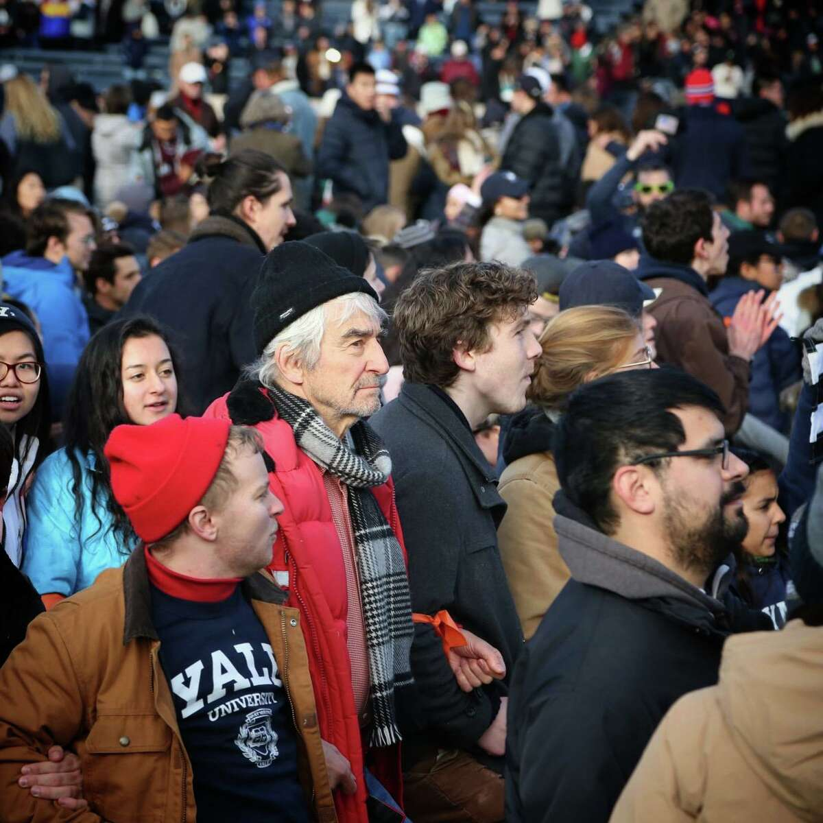Sam Waterston, center, was among 42 people arrested at the Yale Bowl Saturday in a climate change protest over Yale's and Harvard's endowment holdings in fossil fuel companies.