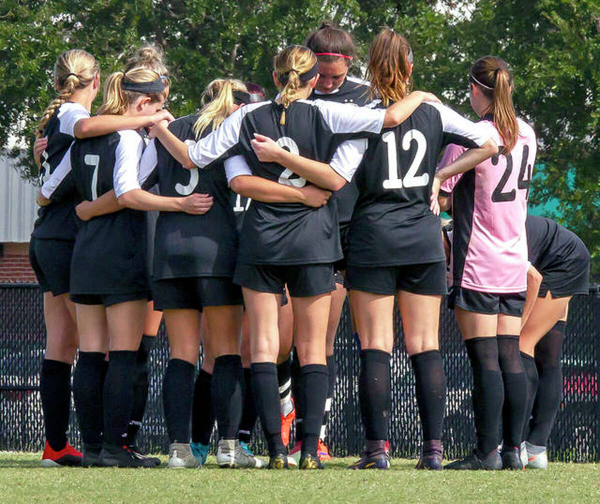 The LCCC Trailblazers huddle up for the second half of their national semifinal game against Monroe College Friday in Melbourne, Fla,