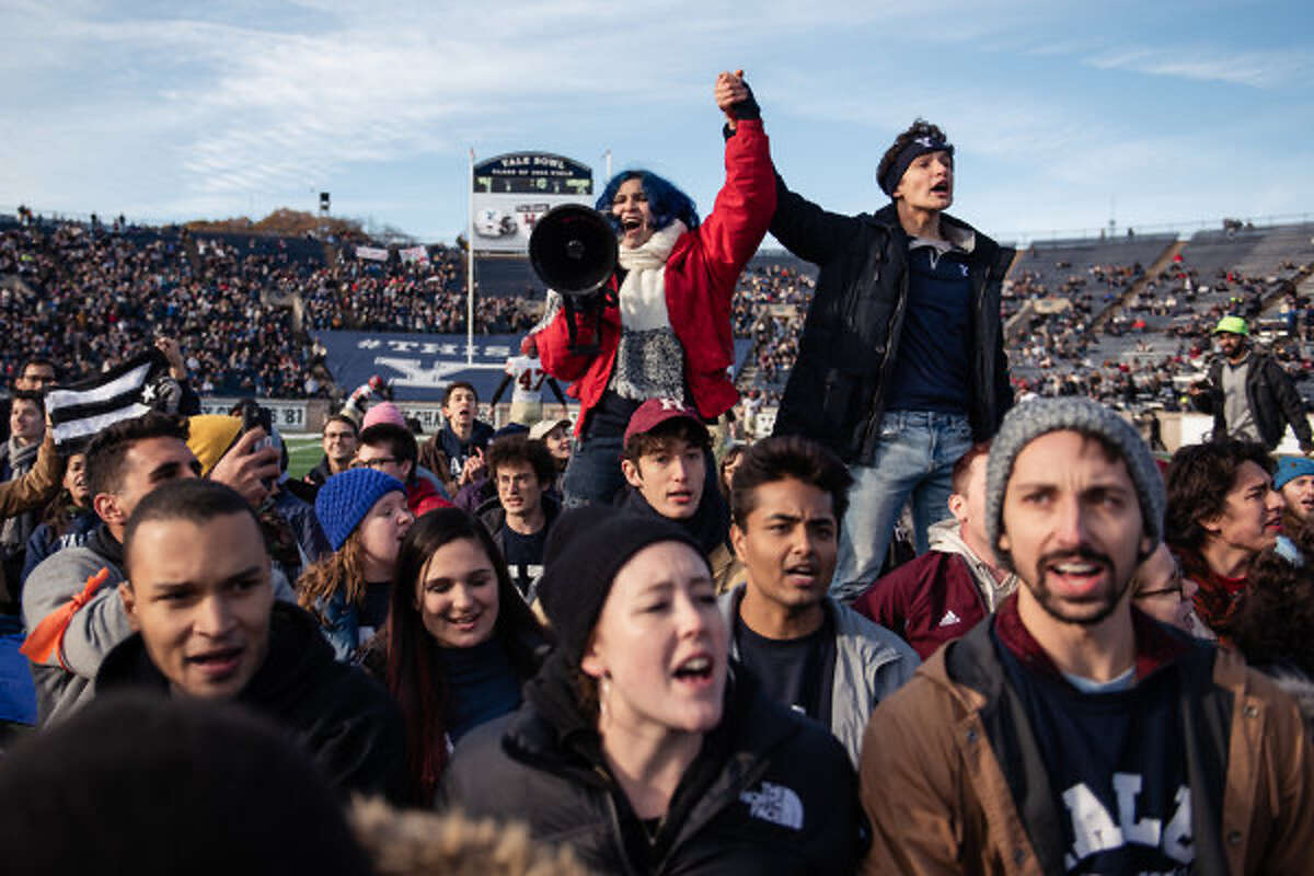 Protestors took to the field of the Yale Bowl on Saturday November 23, 2019 in defense of the climate crisis, during the Yale-Harvard football game.