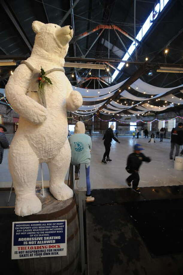 A stuffed polar bear welcomes skaters to the ice at The Loading Dock rink in Grafton. The rink opened for the season on Saturday, offering ice skating through March 8. The rink is closed Thanksgiving Day and Christmas Day.